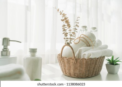 Towels on basket with copy space blurred bathroom background. For product display montage.