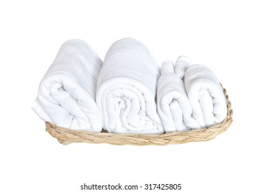 Towels on basket isolated on white background