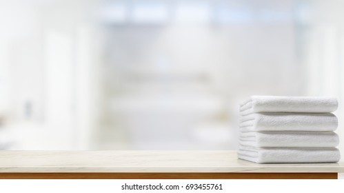 Towels on marble top table with copy space on blurred bathroom background. For product display montage.