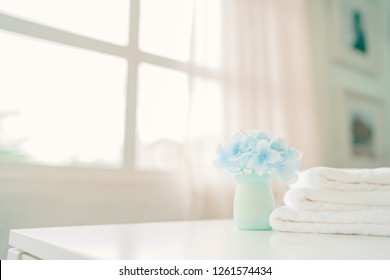 Towels on white table with copy space on blurred background. For product display montage.