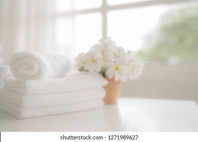 Towels on white table with copy space on blurred background. For product display montage