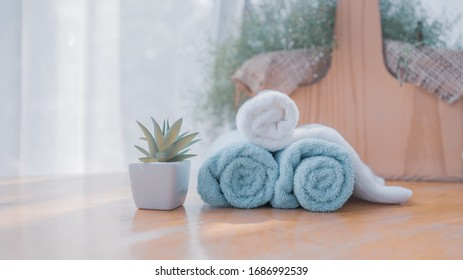 Towels on wood table with blurred background, copy space for product display
