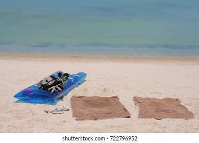 Towels and water supplies are placed on the beach