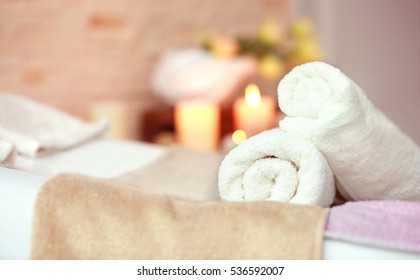 Towels in wellness center on blurred background