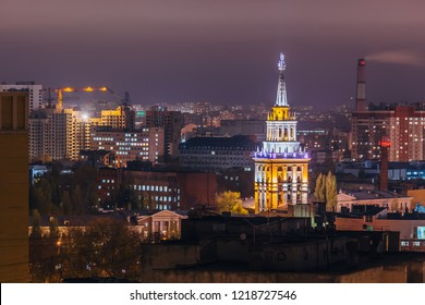 Tower in architecture Stalinist empire with star illuminated by colored lights at night. Voronezh, Russia.