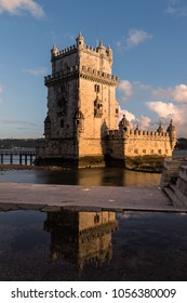 tower of Belem at sunset with reflections