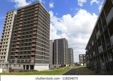 Tower block council housing estate in the UK.  The nearest block is being dismantled for demolition.
