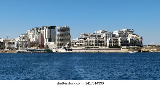 Tower blocks and shopping region of Sliema, Malta as viewed from the Sliema to Valletta passenger ferry