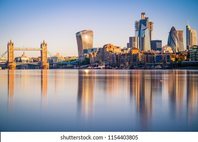 Tower Bridge and the bank district of central London with famous skyscrapers and other landmarks at sunrise
