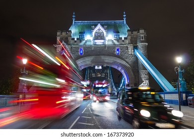 Tower Bridge Buses and a Taxi