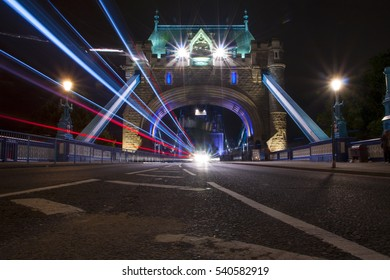 tower bridge by night, with light flairs, london, great britain