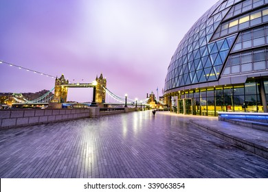 Tower Bridge and City Hall at sunrise in London, England