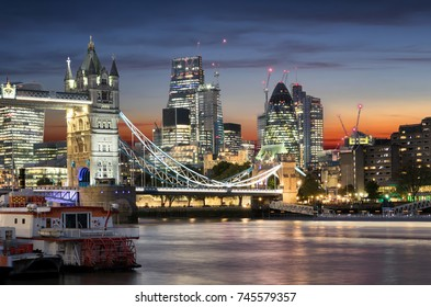 The Tower Bridge and the City of London, United Kingdom, after sunset