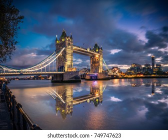 Tower Bridge  at dusk illuminated and reflected in Thames river
