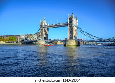 Tower Bridge, famous iconic symbol of London,  crosses the River Thames close to the Tower of London located in London, England, United Kingdom