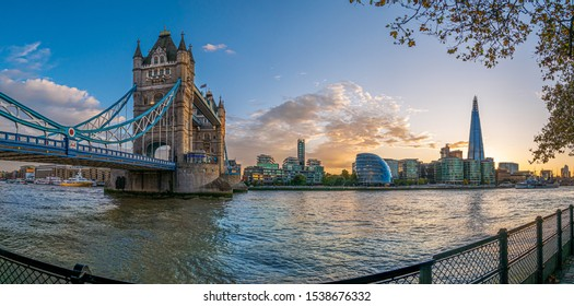 Tower bridge and famous landmarks of London on Thames riverside in fall season, Great Britain