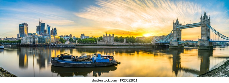 Tower Bridge and financial district at sunrisse in London, England