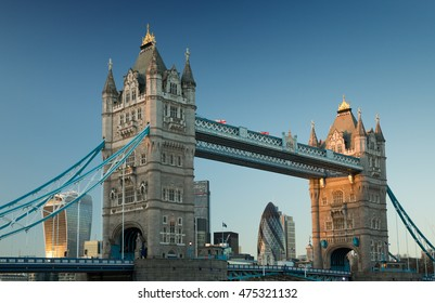 Tower bridge and the Gherkin and Walkie-talkie buildings at sunset in London.