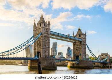 Tower Bridge in London during sunset with London'??s financial district at the background