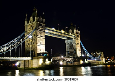 Tower bridge in London England at night over Thames river