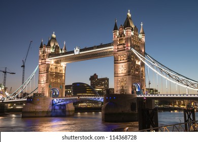 The Tower bridge in London illuminated at night