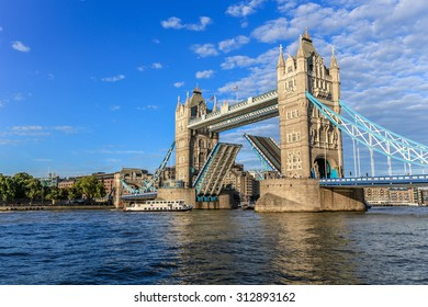 Tower bridge, London, open to let boats through