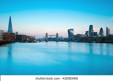 Tower Bridge and London skyline at sunrise