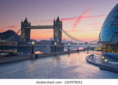 The Tower Bridge in London at sunrise , England