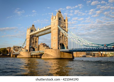 Tower Bridge in London, UK. Tower Bridge is a combined bascule and suspension bridge in London. The bridge crosses the River Thames close to Tower of London and has become an iconic symbol of London