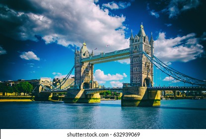 Tower Bridge in London, UK. The bridge is one of the most famous landmarks in Great Britain, England, Picture with sunlight and cloudy sky with high contrast.