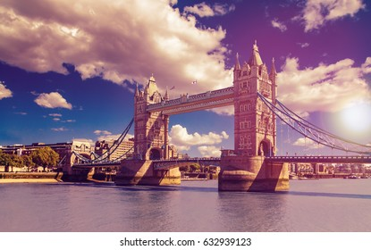 Tower Bridge in London, UK. The bridge is one of the most famous landmarks in Great Britain, England. Picture in a dreamy purple look with sunset feeling.
