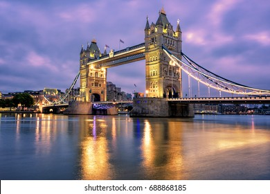 Tower Bridge in London, UK, reflecting in Thames river in dramatic light