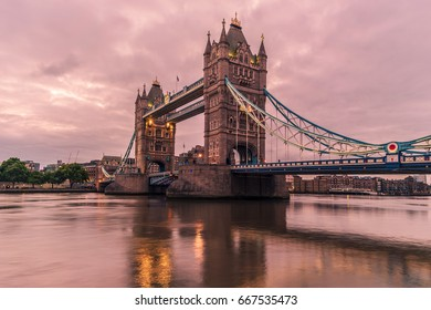 Tower Bridge in London, UK , Sunrise clouds on a early summer morning by the Tower Bridge boulevard, London Tower Bridge