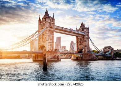 Tower Bridge in London, the UK. Sunset with beautiful clouds. Drawbridge opening. One of English symbols - Shutterstock ID 295742825