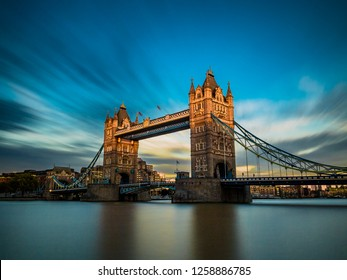 Tower Bridge long exposure, lit by golden sun rays, London