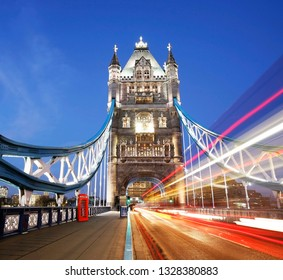 Tower Bridge at night with bus light trails, long exposure image of middle of the road shot.