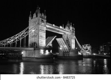 tower bridge at night with open gates