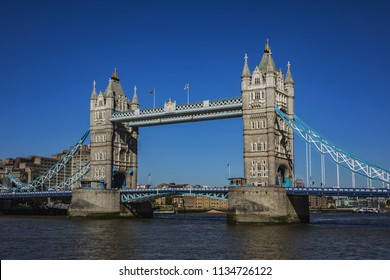 Tower Bridge over River Thames - iconic symbol of London. It is a combined bascule and suspension bridge. Tower Bridge is close to Tower of London, from which it takes its name. London, England, UK.
