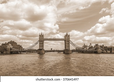 Tower Bridge over River Thames - iconic symbol of London. It is a combined bascule and suspension bridge. Tower Bridge is close to Tower of London, from which it takes its name. Vintage, sepia.