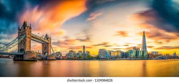 Tower Bridge panorama at sunset in London,. England