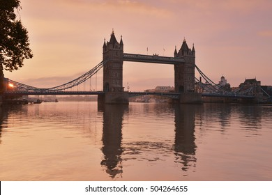 Tower Bridge with reflections at sunrise in London