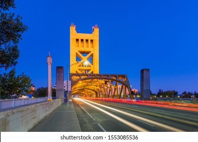 Tower Bridge in Sacramento, California, USA at dusk. It is a vertical lift bridge which crosses the Sacramento River. The bridge opened in 1935.