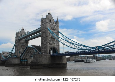 Tower Bridge, sunny day in London. Mobile bridge, located on the River Thames. One of the symbols of the capital. It connects the villages of Southwark and Tower Hamlets, near the Tower of London.