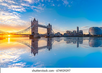 Tower bridge at sunrise with reflection in London,England