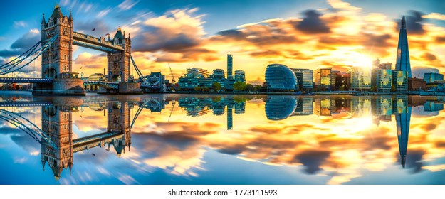 Tower Bridge sunset panorama with reflection in London. England