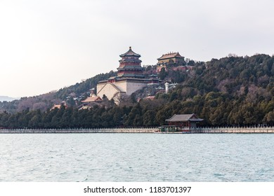 Tower of Buddhist Fragrances and other temples seen from across the lake at the Summer Palace, Beijing, China.