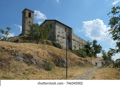 The tower and buildings in the inner courtyard of Torriana fortress, Italy