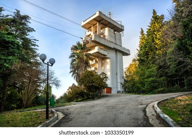 Tower of the cable car in Sochi Arboretum among tall trees