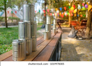 Tower of cans in front for throwing game at fun fair, Game shoot canned for outing party, Recreational pleasure