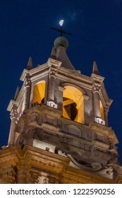 Tower of a cathedral and the moon at Plaza de Armas square in Arequipa, Peru.